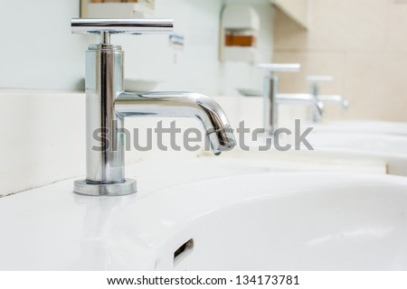 faucet in bathroom - stock photo