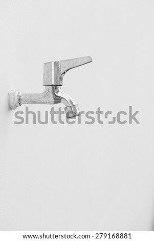 Faucet isolated on white wall background
