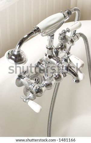 faucet on an antique bath tub - stock photo
