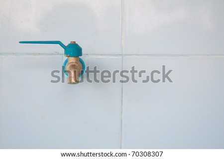 faucet  on the wall - stock photo