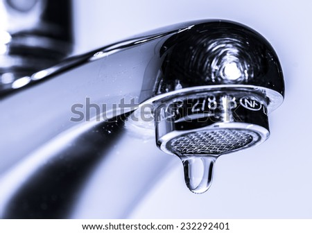 Faucet with dripping water - stock photo