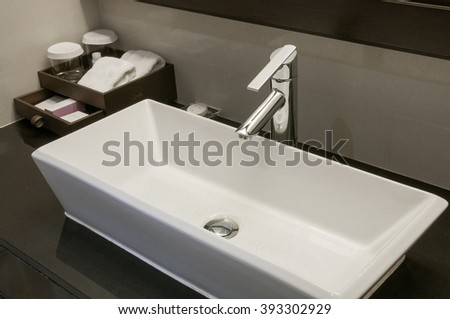 Faucets and sinks ceramic white.