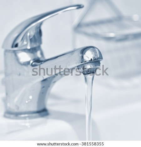 Faucets. Photo in interior bathrooms with running water.
