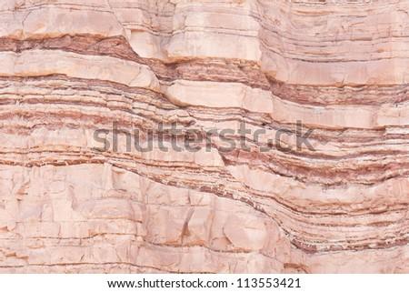 Fault in sandstone strata deformation - stock photo