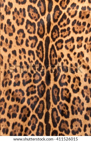Faux leopard fur texture background - stock photo