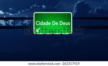 Favela Cidade De Deus Brazil Highway Road Sign at Night - stock photo