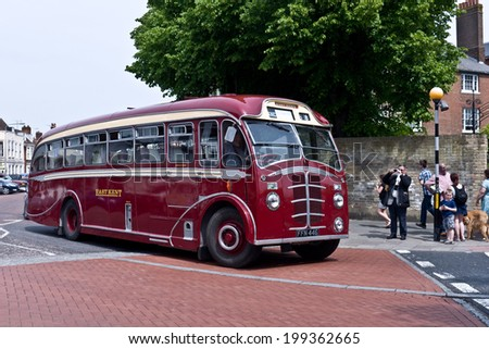 FAVERSHAM, UK-MAY 17: Visitors enjoy the Vintage buses and coaches on display and taking passengers on rides as part of Faversham's Transport weekend. May 17, 2014 in Faversham  Kent, UK. - stock photo
