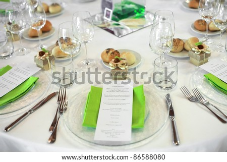 favor on Fancy table set for a wedding with focus on menu - stock photo