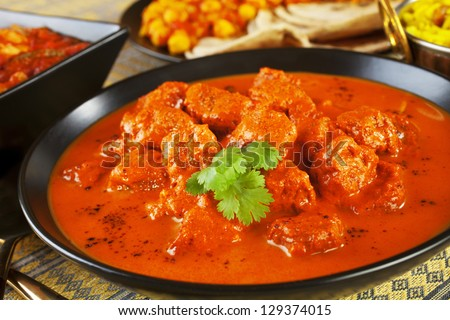 Favourite Indian curry Rogan Josh with chapatis and channa dhal. - stock photo