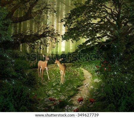 Fawns in the middle of the green forest - stock photo