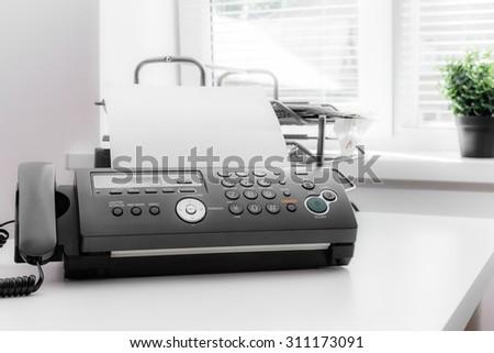 Fax machine, office equipment - stock photo