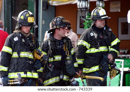 FDNY firefighters after a 2nd alarm in Brighton Beach Brooklyn. - stock photo
