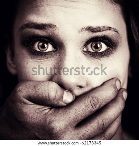 Fear abuse or domestic violence concept. Face of scared female victim