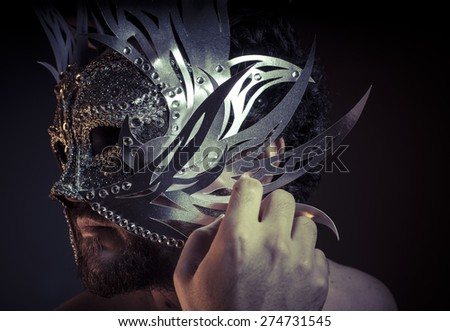 Fear, bearded man with silver mask Venetian style. Mystery and renaissance - stock photo