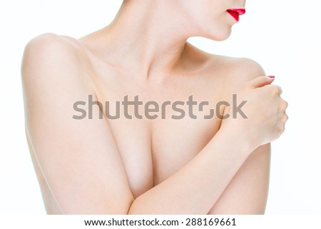 Fear of breast cancer, young female Hugging herself with Red lips
