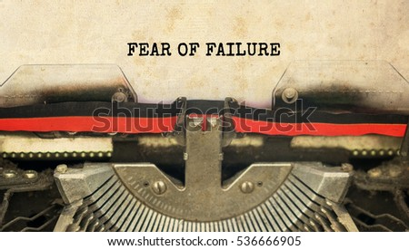 FEAR OF FAILURE typed words on a vintage typewriter with vintage background