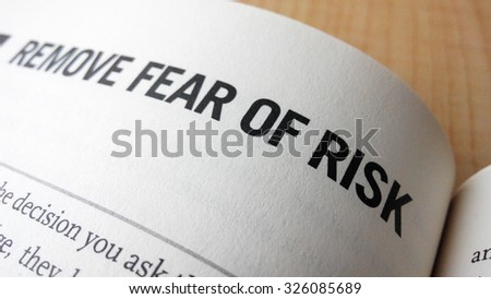 Fear of risk word on a book. Business success concept