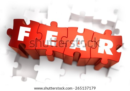 Fear - Text on Red Puzzles with White Background and Selective Focus. - stock photo