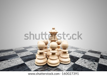 Fearless pawns standing in allround defence ready to fight for a chess queen. - stock photo