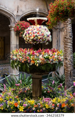 Feast of Corpus Christi. Eggs on jet of water in the fountains decorated with flowers at gothic district - stock photo