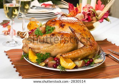Feasting backed turkey on holiday table ready to eat - stock photo