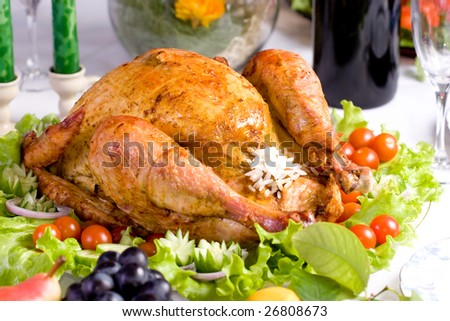 Feasting baked turkey on holiday table ready to eat - stock photo