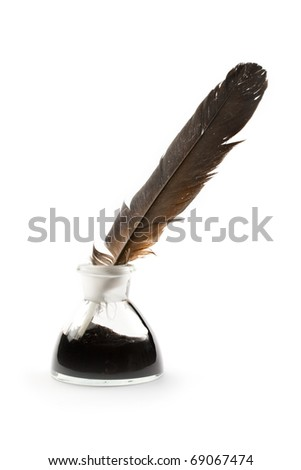 Feather and ink bottle isolated on white - stock photo