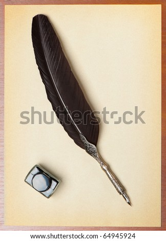Feather quill and inkwell on an old paper. Isolated on white - stock photo