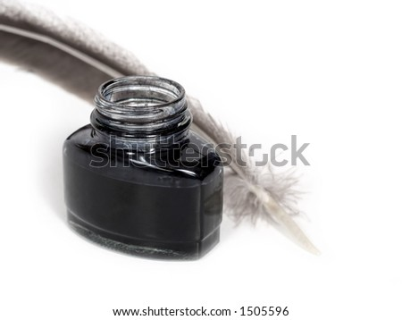 feather quill and inkwell over white background - stock photo