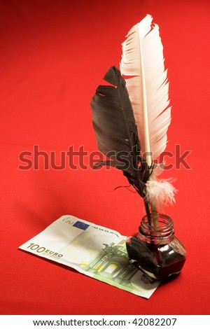 Feather quill, ink and money - stock photo