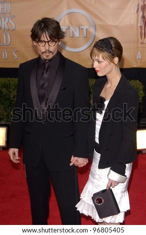 Feb 06, 2005: Los Angeles, CA: JOHNNY DEPP & VANESSA PARADIS at the 11th Annual Screen Actors Guild Awards at the Shrine Auditorium. - stock photo