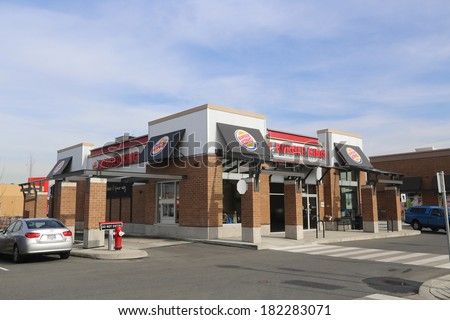 February 26, 2014. A New Burger King fast food restaurant is pictured in Port Coquitlam BC Canada. At the end of fiscal year 2013, Burger King reported it had over 13,000 outlets in 79 countries. - stock photo