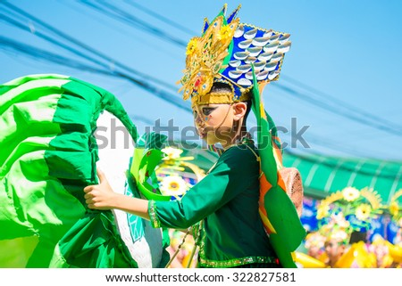 February 27, 2015 Baguio, Philippines. Baguio Citys Panagbenga Flower Festival. Unidentified people on parade in carnival costumes. Documentary Editorial Image.