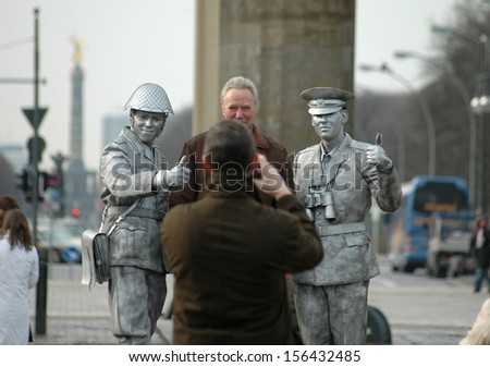FEBRUARY 2007 - BERLIN: tourists and actors disguised as soldiers at the Brandenburg Gate, Pariser Platz, Berlin.