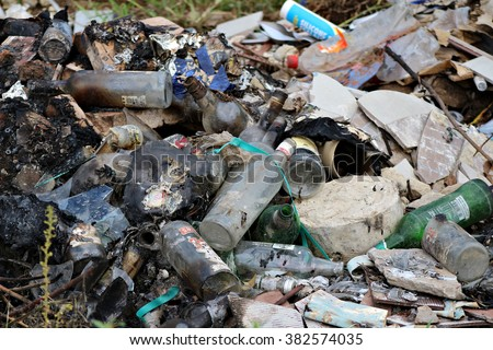 FEBRUARY 27, 2016: Discarded refuse and rubbish lies in a pile on a dump in a rural area in South Africa. - stock photo
