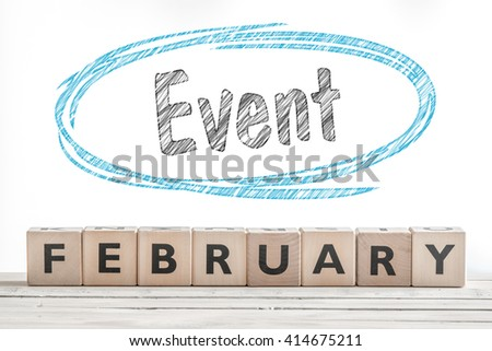 February event sign made of wood on a stage - stock photo
