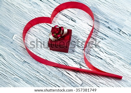 February 14, giftbox, Valentine's day, heart from red ribbon - stock photo
