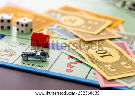 February 8, 2015 - Houston, TX, USA.  Monopoly game board with car on Park Place - stock photo