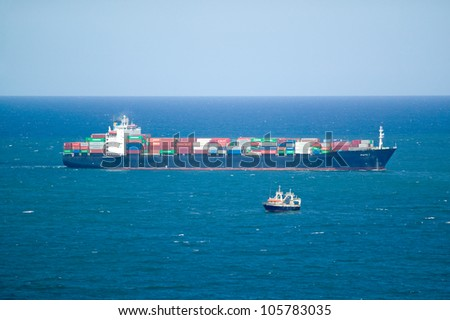 FEBRUARY 2006 - Large cargo ship bringing cargo containers to Durban, South Africa on the Indian Ocean