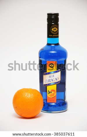 FEBRUARY 2010, NIS, SERBIA - Bottle of Orlando brand of blue curacao liqueur, blue liqueur made from bitter oranges which is essential ingredient in many cocktails. Isolated on white.