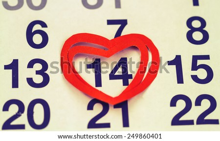 February 14, 2015 on the calendar, Valentine's day,  heart from red paper - stock photo