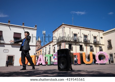 February 12, 2016, Queretaro, Mexico: a man is performing opera music in public in a plaza n Mexico