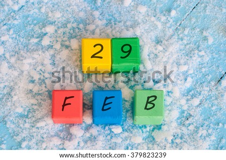 February 29th. Calendar date on color wooden cubes with marked Date 29 of february. Winter end concept, leap year - stock photo