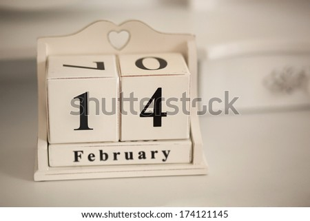 February 14 vintage calendar with a hole in the shape of heart. A holiday - Valentine's Day - stock photo