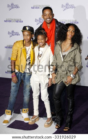 "February 8, 2011. Will Smith, Jada Pinkett Smith, Jaden Smith and Willow Smith at the Los Angeles premiere of ""Justin Bieber: Never Say Never"" held at the Nokia Theatre L.A. Live, Los Angeles.  - stock photo"