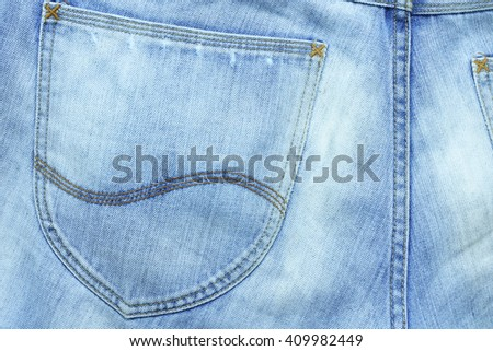 Fed jean on pocket with a blue tone - stock photo