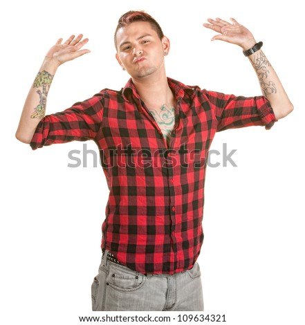 Fed up male with spiky hair and hands in the air - stock photo