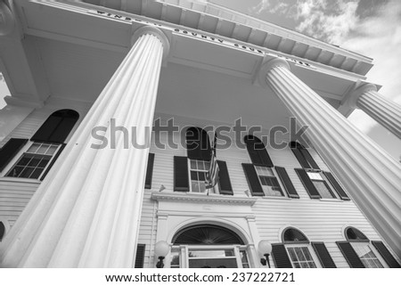 Federal architectural detail Windham County Court House in Newfane is the architectural focus of the village since its erection in 1825. Black and white image. - stock photo