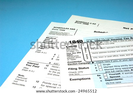 Federal Income Tax Forms on Blue Background