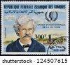 FEDERAL ISLAMIC REPUBLIC COMOROS - CIRCA 1985: A stamp printed in Comoros shows Mark Twain, circa 1985 - stock photo